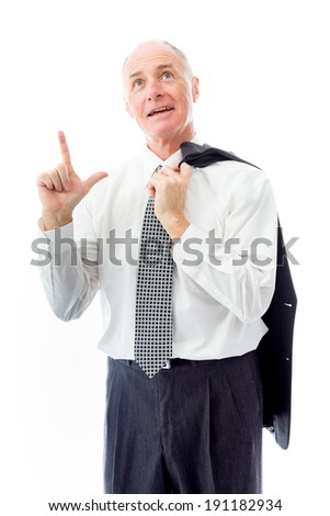 Businessman pointing up and day dreaming - stock photo