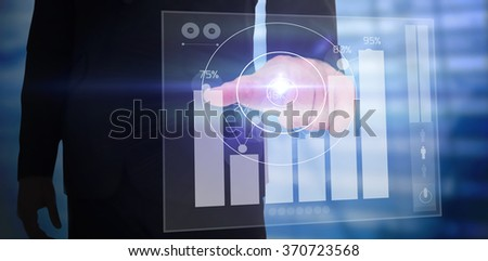 Businessman pointing with finger against percentages graphical representation - stock photo
