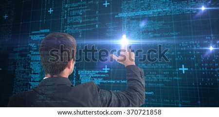 Businessman pointing with his fingers against blue matrix and codes - stock photo
