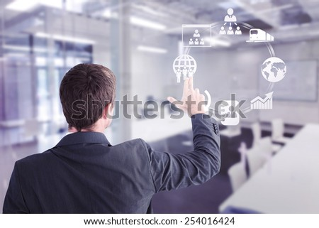 Businessman pointing with his fingers against classroom
