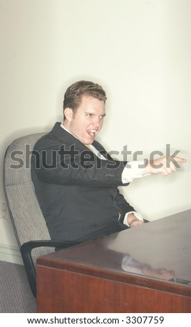 Businessman points his finger and hand forward and gives a shout of success - stock photo