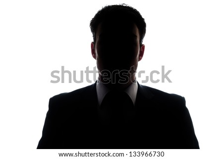 Businessman portrait silhouette and a mysterious face - stock photo