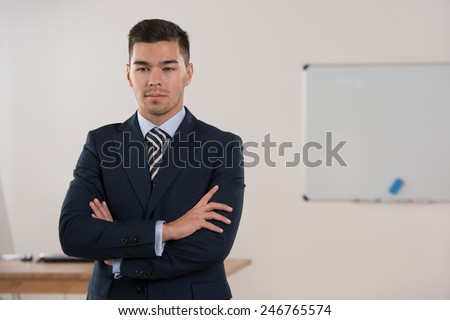 Businessman portrait standing calm and thoughtful at office - stock photo