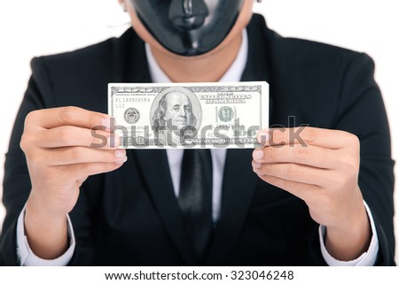 businessman portraits black mask on the face, money in hand,  on white background - stock photo