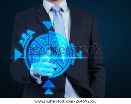businessman poshing business scheme on blue background - stock photo