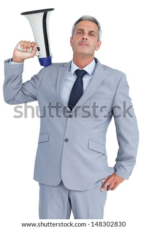 Businessman posing on white background with loudspeaker on his shoulder - stock photo