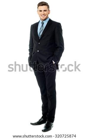 Businessman posing stylishly on white background - stock photo