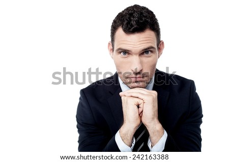 Businessman posing to camera while having a deep thought - stock photo