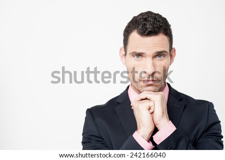 Businessman posing to camera with a serious face - stock photo