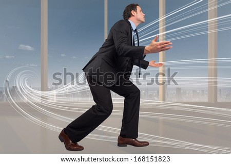 Businessman posing with arms outstretched against abstract white line design in room