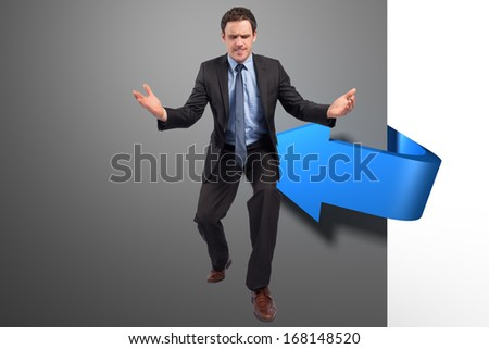 Businessman posing with arms outstretched against blue arrow graphic
