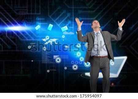 Businessman posing with arms raised against futuristic black and blue background