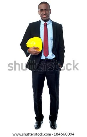 Businessman posing with construction helmet - stock photo