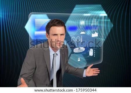 Businessman posing with hands out against shiny hexagons on black background