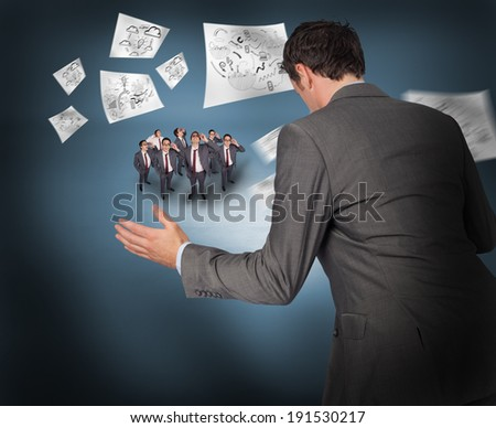 Businessman posing with hands out with tiny businessmen against purple vignette