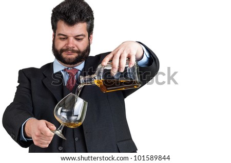 Businessman pouring  a glass of whisky - stock photo