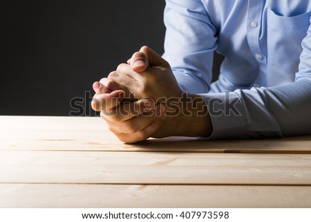 Businessman pray for something.Low key photo style