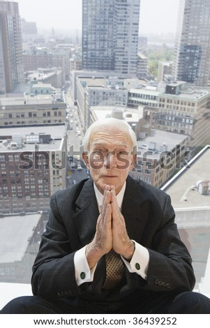Businessman praying to meet the numbers. - stock photo