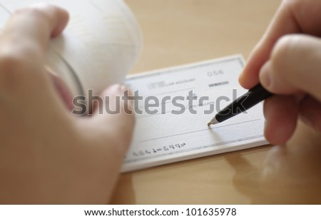 Businessman prepare writing check in the office - stock photo