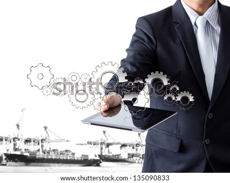 businessman present gear with tablet