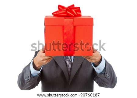 Businessman present red gift box with ribbon bow, isolated over white background. - stock photo