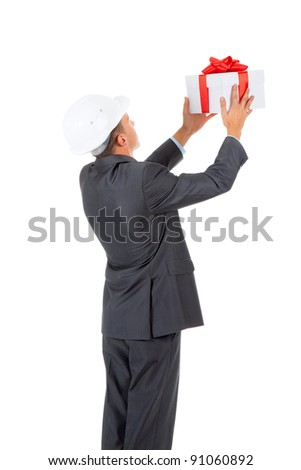 Businessman present white gift box with red ribbon bow, isolated over white background. - stock photo