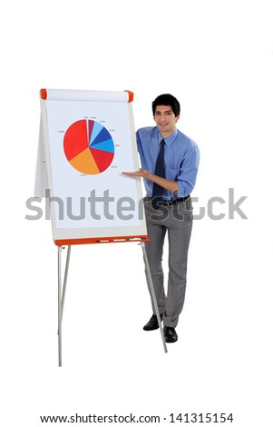 Businessman presenting a pie chart - stock photo
