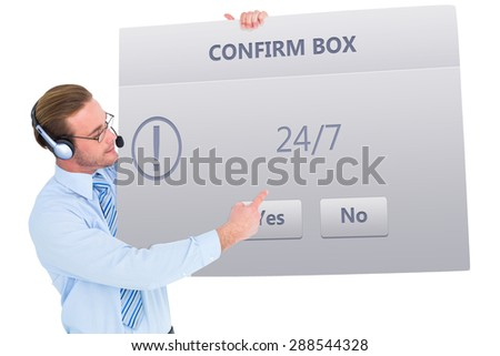 Businessman presenting card wearing headset against confirm box - stock photo