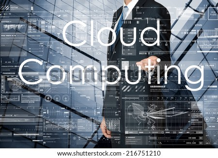 businessman presenting Cloud Computing and drawing graphs and diagrams with skyscraper in background - stock photo