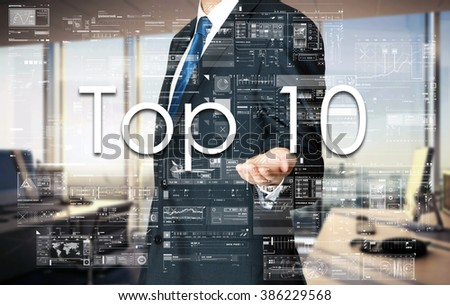 Businessman presenting text Top 10 on virtual screen. He is in the office - stock photo