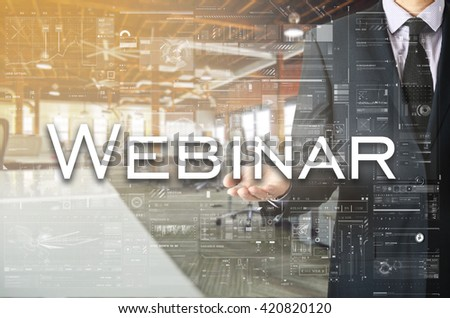 Businessman presenting text Webinar on virtual screen. He is in  - stock photo