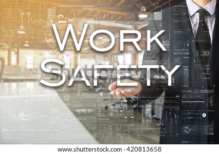 Businessman presenting text Work Safety on virtual screen. He is - stock photo