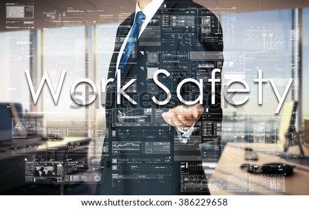 Businessman presenting text Work Safety on virtual screen. He is in the office - stock photo