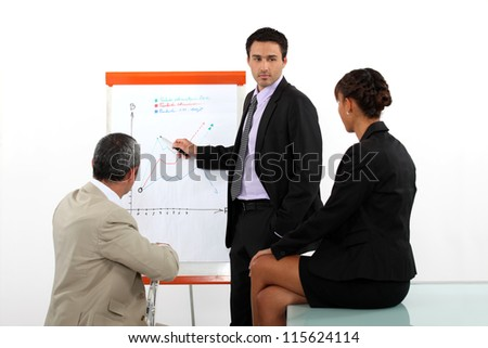 Businessman presenting the results of a market research - stock photo