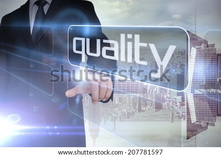 Businessman presenting the word quality against room with large window looking on city