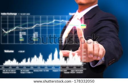 businessman press on graph  - stock photo