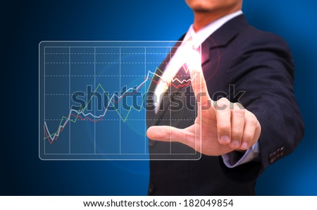 businessman press on graph  - stock photo