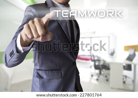 Businessman press teamwork of business conceptual - stock photo