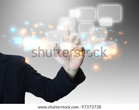 Businessman press touchscreen - stock photo