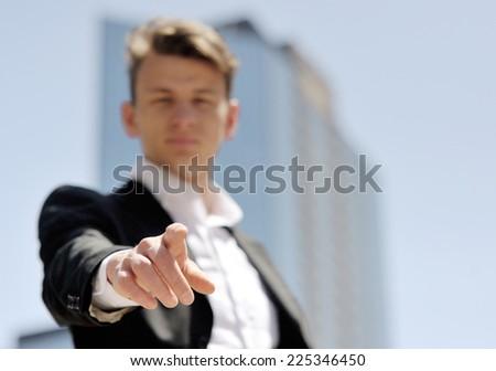 businessman press virtual button - technology, internet and networking conceptnessman press virtual login button - stock photo