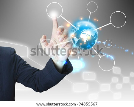businessman press world diagram - stock photo