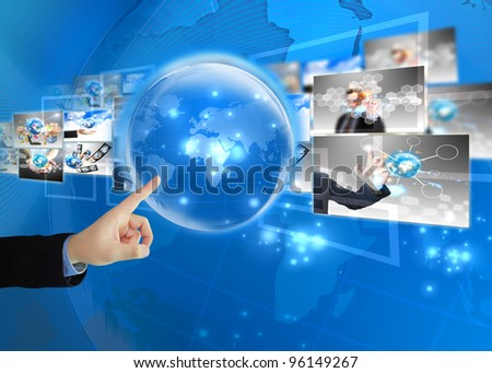 Businessman press world .Technology concept