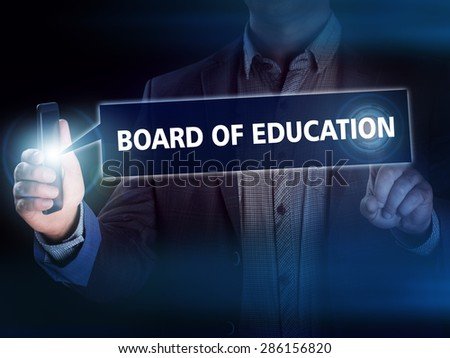 Businessman presses button board of education on virtual screens. Business, technology, internet and networking concept. - stock photo