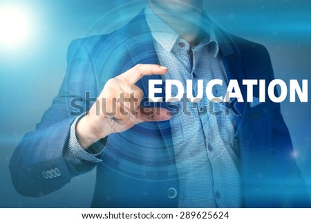 Businessman presses button education on virtual screens. Business, technology, internet and networking concept. - stock photo