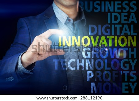 Businessman presses button innovation on virtual screens. Business, technology, internet and networking concept. - stock photo
