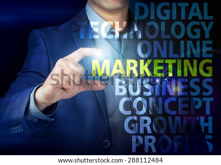 Businessman presses button  marketing on virtual screens. Business, technology, internet and networking concept.