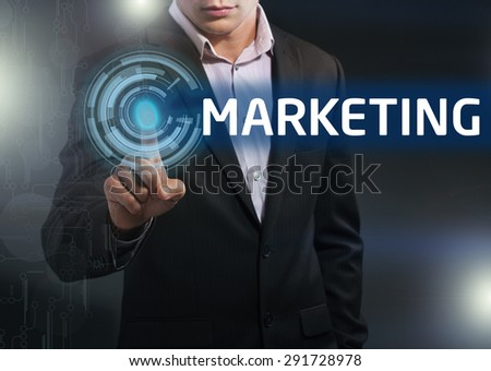 Businessman presses button marketing on virtual screens. Business, technology, internet and networking concept. - stock photo