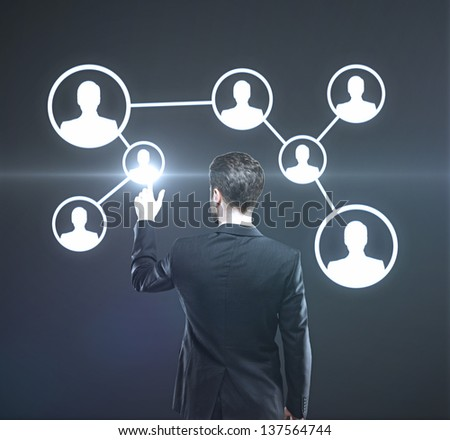 businessman presses button on interface, social media concept - stock photo