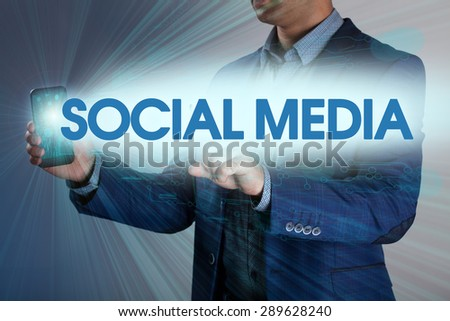 Businessman presses button social media on virtual screens. Business, technology, internet and networking concept. - stock photo