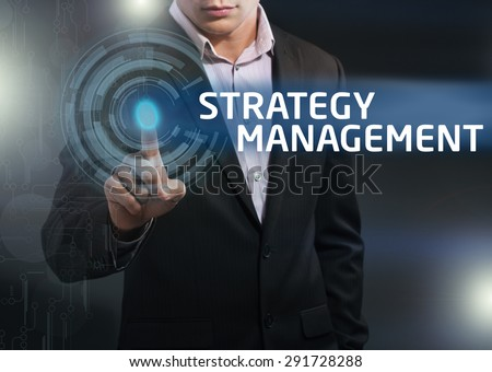 Businessman presses button strategy management on virtual screens. Business, technology, internet and networking concept. - stock photo
